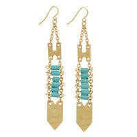 """Burnished gold tone fishhook earrings featuring turquoise beads with a hammered arrowhead. Approximately 3 1/4"""" in length."""