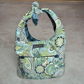 small unique purse -- blue, green, brown, and white paisley patterned with tie handle, magnetic snap, and pockets