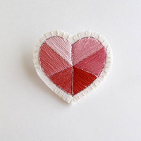 Embroidered heart brooch for Valentines day with geometric pinks, reds and metallic thread on cream muslin An Astrid Endeavor gifts for her
