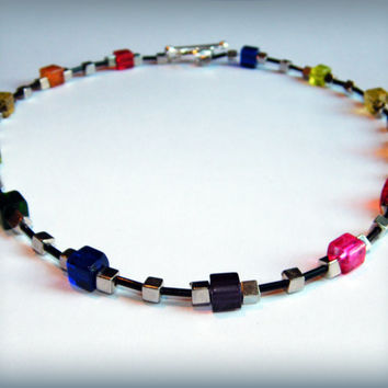 Rainbow and black glass bead necklace with a toggle clasp