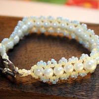 SHERBET PEARLS BRACELET / beadwoven bracelet featuring cream glass pearls, light blue and yellow seed beads, & silver-plated toggle