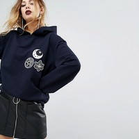 Rokoko Halloween Oversized Hoodie With Celestial Patches at asos.com