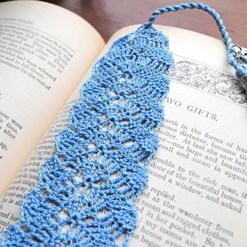 Crochet lace bookmark with a tassel and charms, light blue