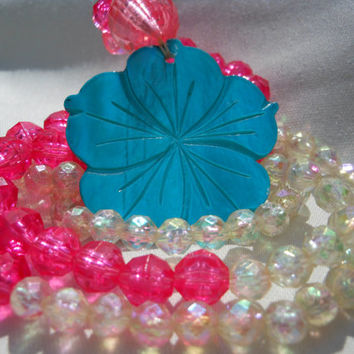 Hibiscus Flower Necklace Blue Shell Pendant Pink and Clear Plastic Iridescent Beads Hawaiian Jewelry Style 34 inches Beach Resort Floral