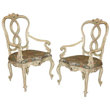 A pair of polychrome-painted wood armchairs