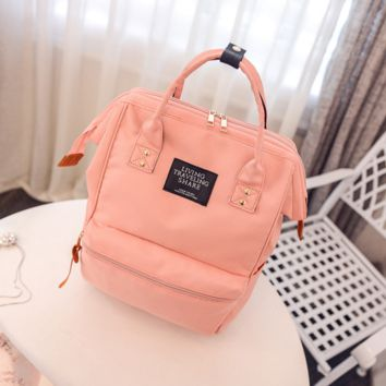The new wave of schoolbags shoulder bag female high - capacity computer backpack college wind Solid color student backpack