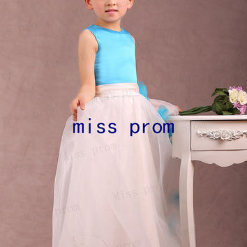 Flower girl dress made of tulle and satin with sash and flowers