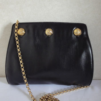 Vintage Salvatore Ferragamo black leather shoulder purse with gold tone chain and shoe motif round coin motifs at front. Can be clutch bag