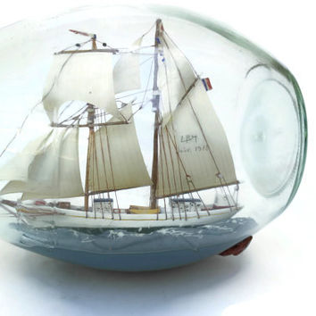 Ship in a Bottle.  Maritime Collectibles. Miniature Boat Model in Glass Bottle.