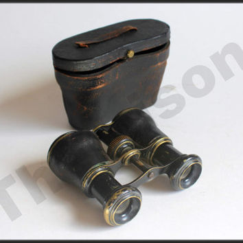 1900s vintage brass, leather bounded opera binoculars, in working condition. With case.