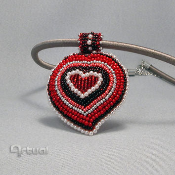 Red beaded heart pendant on silk cord