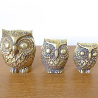Three brass owl paperweights, figurines