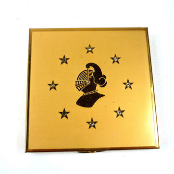 Art Deco Rho Jan Compact with Mirror Powder Puff and Screen Gold Colored Knight with Rhinestones