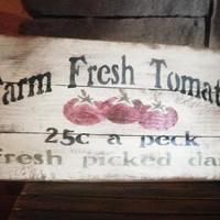 """Sign  """"Farm Fresh Tomatoes """" Looks like the old produce signs of days past."""
