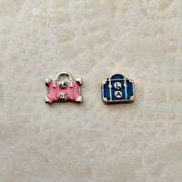 Floating charms travel pink suitcase ... Blue suitcase