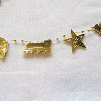 Vintage Gold Plastic Garland Train Trumpet Star