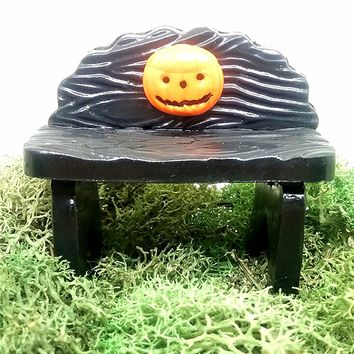 Fairy garden accessories. Miniature Halloween bench with jack-o-lantern.