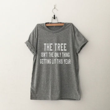 Funny Christmas sweater tshirt women graphic tee teen clothes teenager gift for her women tshirt the tree isn't the only thing getting lit