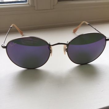 Ray Ban Womens Sunglasses with round blue lenses