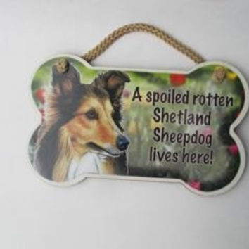 "Dog Lovers' Decorative Dog Bone Shape Wooden Wall Plaque Sign 10' X 5"" - A Spoiled Rotten Shetland Sheepdog Lives Here!"