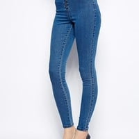 ASOS High Waist Denim Jeggings in Mid Wash Blue With Zip Front Detail