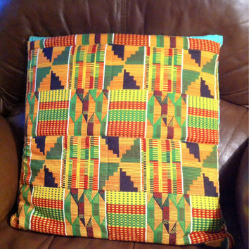 Geometric quillow, a quilt that folds into a pillow, handmade quilt