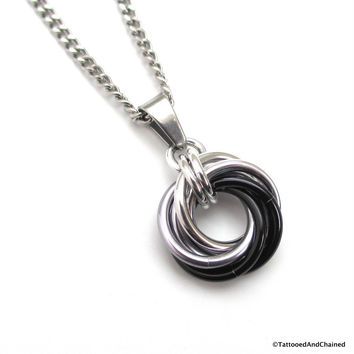 Silver, gray, and black pendant, chainmaille love knot