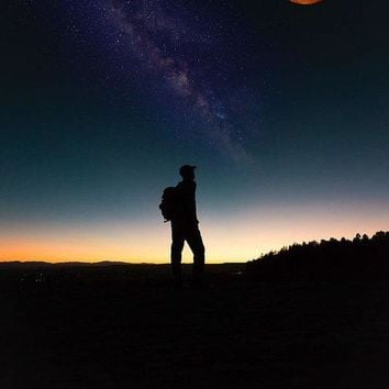 The Milky Way, The Blood Moon And The Explorer By Adam Asar - Art Print