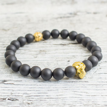 Matte black onyx beaded stretchy bracelet with gold skull, custom made yoga bracelet, mens bracelet, womens bracelet