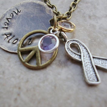 Never Alone antiqued brass hand stamped necklace withtwo crystals peace charm and awareness ribbon charm