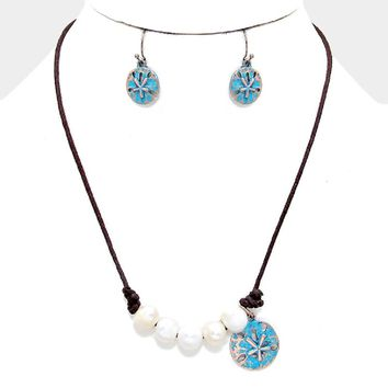 "Sand Dollar Charm Imitation Pearl Beaded Leather Necklace. Necklace : 18"" + 3"" L. Decor : 1.25"" L. Earrings : 1"" L."