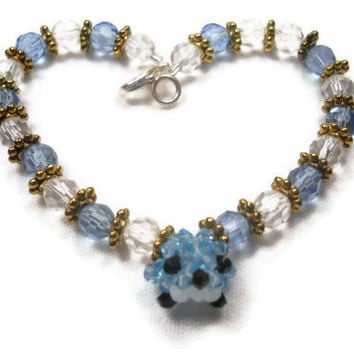 Charm Bracelet With Blue Beaded Bird