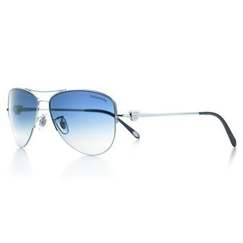 Tiffany & Co. -  Return to Tiffany™ aviator sunglasses with blue acetate temple tips.
