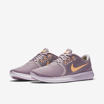 The Nike Free RN CMTR Women's Running Shoe.