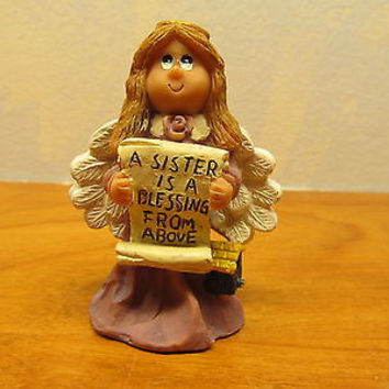 PLASTIC SISTER ANGEL FIGURINE HOLDING A PLAQUE FOR YOUR SISTER