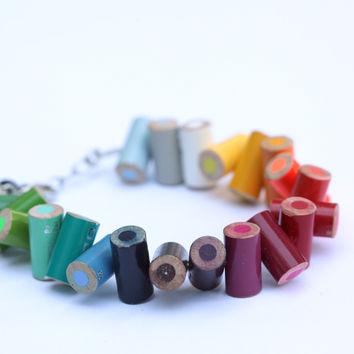 Colored pencil bracelet with extension