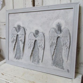 Angels on large framed board metal wings soft gray silhouettes of three angels white halos surround them by Anita Spero
