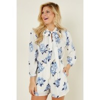 Quiet Confidence White And Blue Floral Print Romper