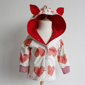 Cool reversible baby hoodie with ears. White organic knit fabric with hearts and red jersey. Size: 12 months. Ready to ship