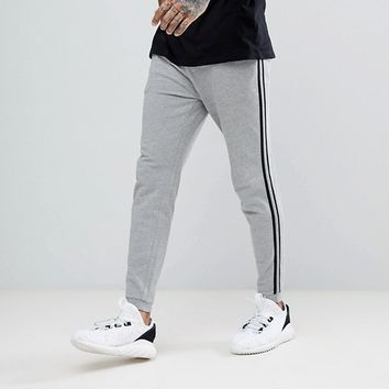 ASOS Skinny Joggers With Side Stripe In Grey Marl at asos.com