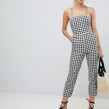 ASOS DESIGN denim jumpsuit with strappy back in gingham at asos.com