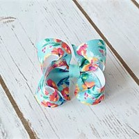 Small baby girl turquoise hair bow with colorful flowers. 3 inch bow is available on an alligator clip, snap clip or barrette. Your Final Touch Hair Accessories