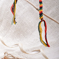 Handmade thin friendship wrist bracelet woven of