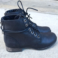 A Lace Up Combat Bootie in Black