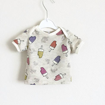 Baby lap neck shirt with sparkly ice creams. Toddler t-shirt. Kid's top. Ecru shirt with multi color popsicles. Cotton knit fabric. Glitter
