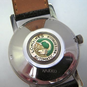 RARE LONGINES 24 JEWEL CONQUEST STAINLESS AUTOMATIC WRISTWATCH. FULL SERVICE.