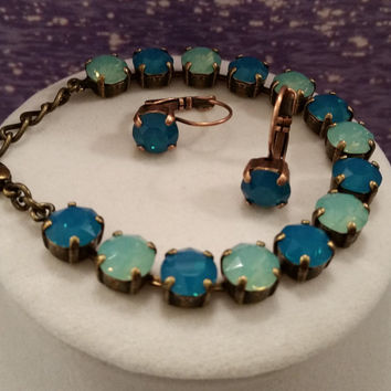 swarovski  crystal bracelet done in blue and green opals in copper setting #31.