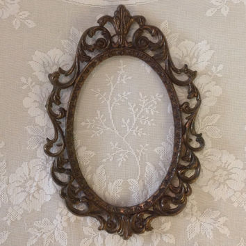Victorian cast metal oval frame antiqued gold tone patina shabby chic romantic cottage wall hanging home decor