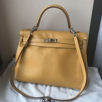 Hermes Kelly 32 bag Retourne Curry Clemence leather Silver hardware.