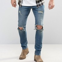 Mennace Slim Jeans With Rips In Mid Wash at asos.com